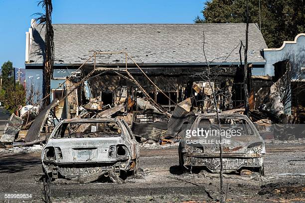 TOPSHOT Cars destroyed in the Clayton Fire are seen in Lower Lake California August 15th 2016 A northern California wildfire grew rapidly over the...