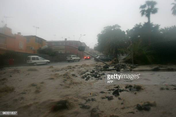 Cars drive a flooded street after heavy rainfall during Storm Altlantica in Santa Cruz de Tenerife on the Spanish Canary island of Tenerife on...