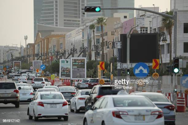 Cars drive along a busy street on June 20 2018 in Riyadh Saudi Arabia In a largescale effort to develop public transportation the city is investing...