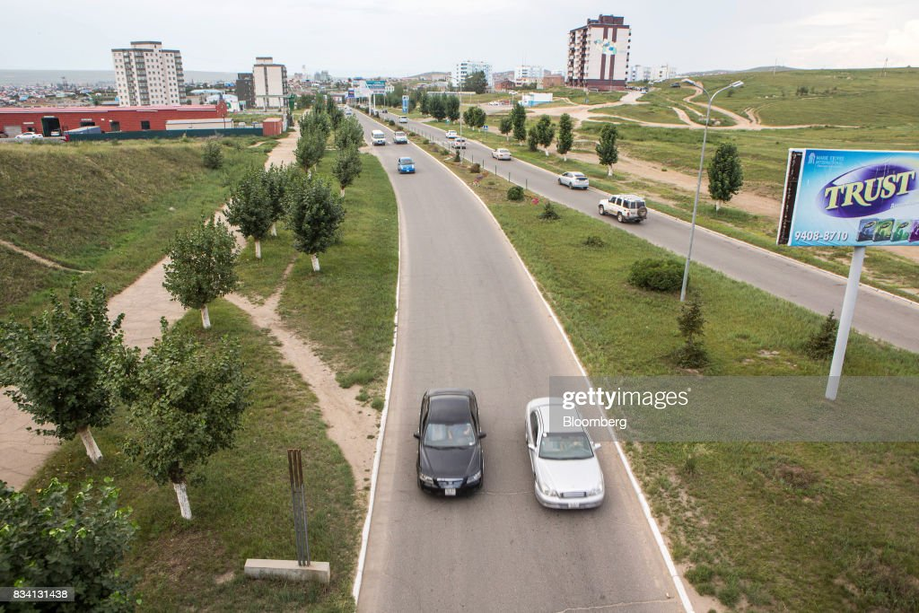 Cars drive along a road on the outskirts of Darkhan, Mongolia, on Monday, Aug. 14, 2017. Mongolia, desperate to make more of its abundant resources as it seeks to revive its flailing economy, aims to make that vision a reality through one of the world's most ambitious power projects. The landlocked nation is considering a $7 billion plan to build coal, wind and solar plants that could send electricity across China, Russia, South Korea and Japan, according to the Shivee Energy Complex. Photograph: Taylor Weidman/Bloomberg via Getty Images