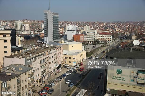 Cars drive along Agim Ramadani avenue in the city center on March 19, 2016 in Pristina, Kosovo. Kosovo, following the Kosovo War of 1999 and its...