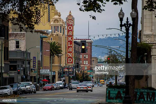 Cars drive along Telegraph Avenue in Oakland California US on Tuesday Nov 18 2014 Oakland long synonymous with crime and blight is attracting...