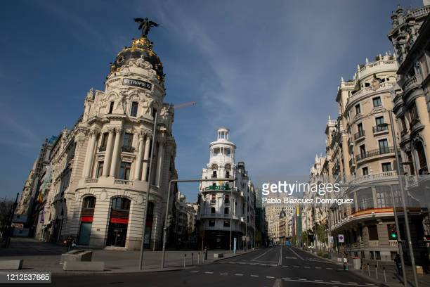 Cars drive along the empty Gran Via Street on March 15, 2020 in Madrid, Spain. The cases in Madrid are 2,807 people infected of Coronavirus and 133...