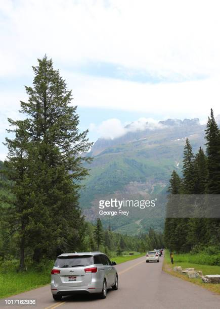 Cars drive along the Going To the Sun Road in Glacier National Park on July 26 2018 in West Glacier Montana Over crowding in National Parks is...
