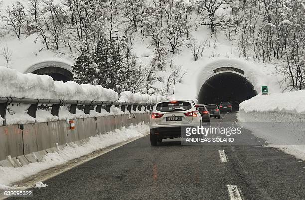 Cars drive along the highway near the main road to Amatrice, after a 5.7-magnitude earthquake struck the region, on January 19, 2017. / AFP / ANDREAS...