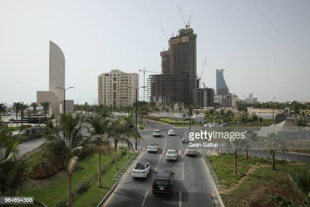 Cars drive along the New Corniche seafront development on June 23 2018 in Jeddah Saudi Arabia The New Corniche includes hotels residential buildings...