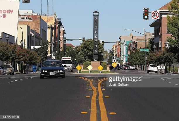 Cars drive by a sign on June 27, 2012 in Stockton, California. Members of the Stockton city council voted 6-1 on Tuesday to adopt a spending plan for...