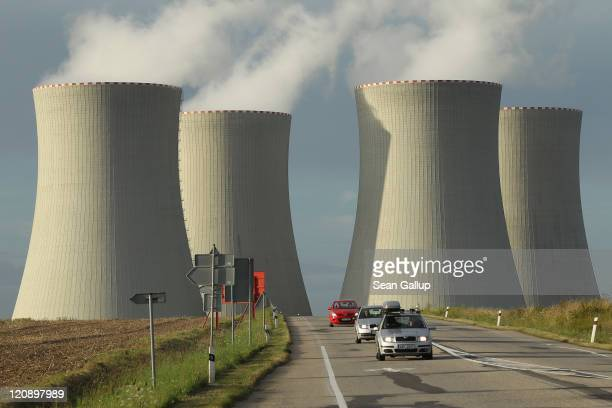 Cars drive by the four cooling towers of the Temelin nuclear power plant on August 11 2011 near Temelin Czech Republic CEZ the Czech stateowned...