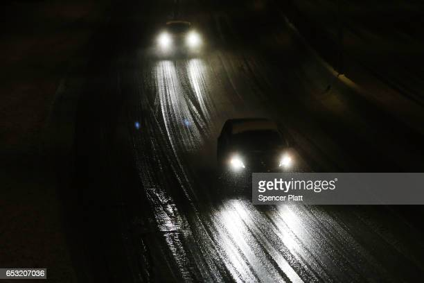 Cars drive down a highway in the sleet and snow on March 14 2017 in New York City New York City and New Jersey are under a state of emergency as a...