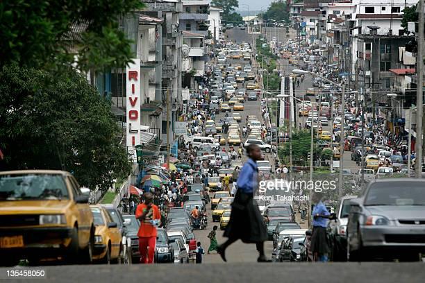 Cars drive down a street April 28 2008 in the city center of Monrovia Liberia Despite President Ellen JohnsonSirleaf's effort to reduce corruption...