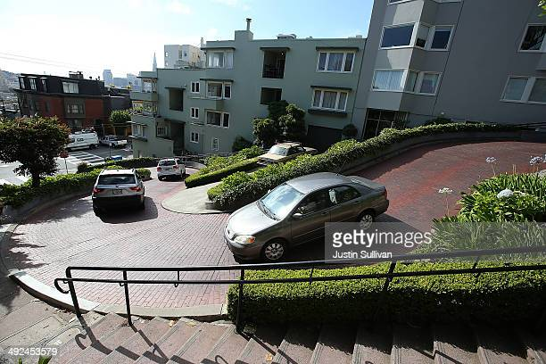 Cars drive down Lombard Street on May 20 2014 in San Francisco California The San Francisco Municipal Transportation Agency Board of Directors is...