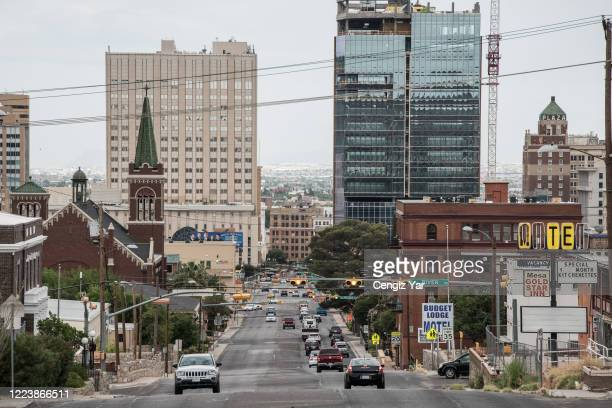Cars drive down Mesa Street on July 1, 2020 in El Paso, Texas. As coronavirus cases have surged in Texas, Gov. Greg Abbott has paused the state's...