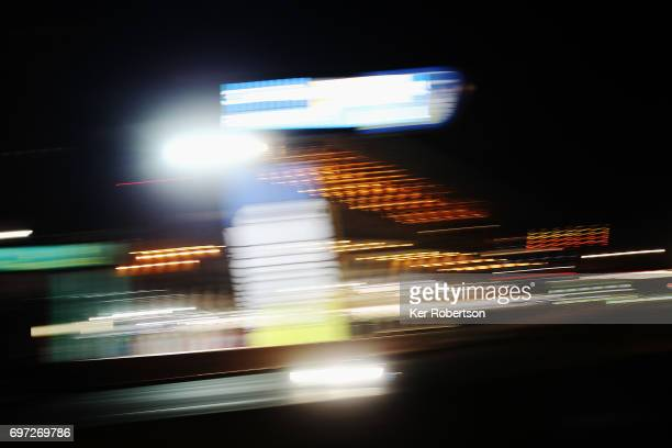 Cars drive down the main straight at night during the Le Mans 24 Hours race at the Circuit de la Sarthe on June 17 2017 in Le Mans France