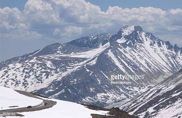 Cars drive down the Trail Ridge Road May 23 2003 in Rocky Mountain National Park Colorado The road was opened for the season May 23 after crews spent...
