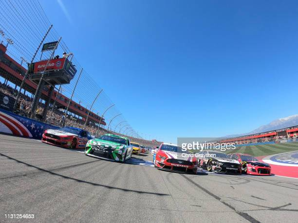 Cars drive five wide prior to the Monster Energy NASCAR Cup Series Auto Club 400 at Auto Club Speedway on March 17 2019 in Fontana California