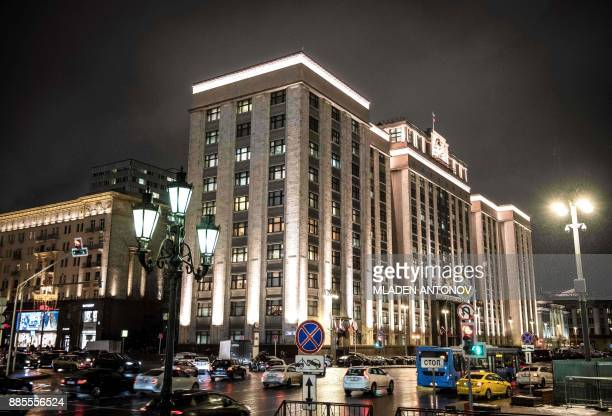 Cars drive in front of the headquarter building housing the State Duma the Lower House of the Federal Assembly of the Russian Federation in Moscow on...