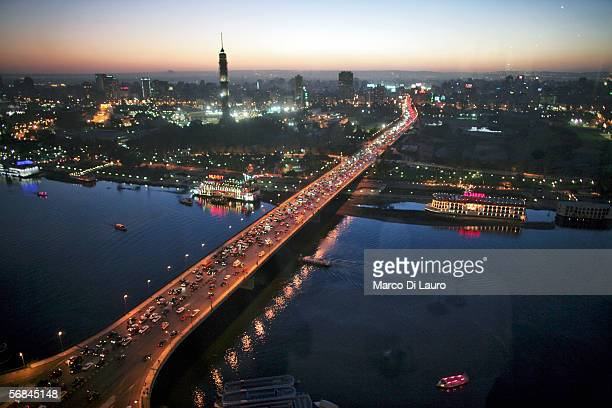 CAIRO EGYPT FEBRUARY 9 Cars drive on a bridge crossing the Nile River on February 9 2006 in Central Cairo Egypt Cairo is still the heart of Egypt and...
