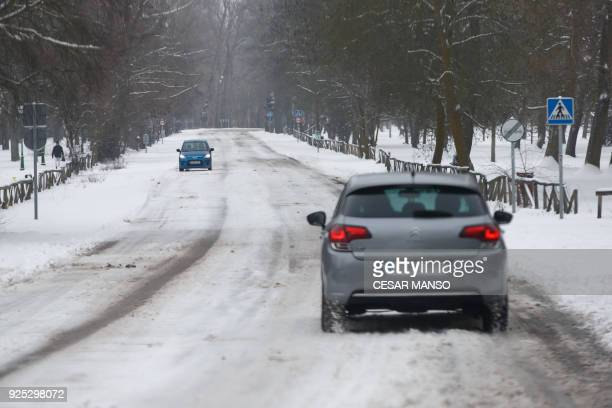 Cars drive on a road covered by snow after a heavy snowfall in Burgos northern Spain on February 28 2018 School was cancelled across swathes of...