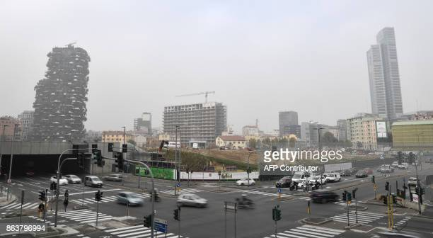 Cars drive on a street in Milan on October 20 as smog has reached alarming levels in northern Italy in recent days Drivers in Milan will face a...