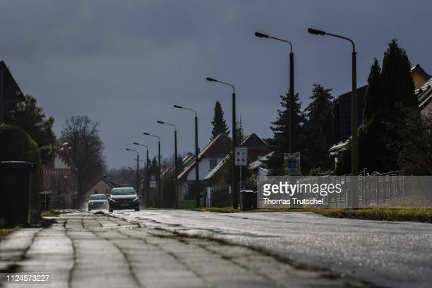 Cars drive on a street with onefamily houses in the district Schoenfliess on February 11 2019 in Eisenhuettenstadt Germany