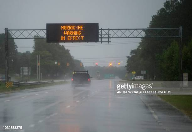 TOPSHOT Cars drive on a wet road as rain from Hurricane Florence falls in Wilmington North Carolina on September 13 2018 Hurricane Florence edged...