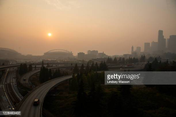 Cars drive on I-5 in front of a hazy Seattle skyline due to wildfire smoke on September 11, 2020 in Seattle, Washington. According to reports, air...