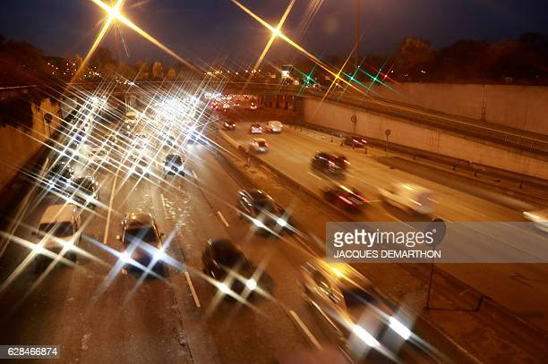 Cars drive on the Peripherique in Paris on December 8 2016 as city authorities announced traffic restrictions would be extended to December 8 with a...