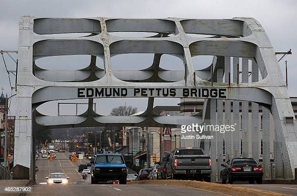 Cars drive over the Edmund Pettus Bridge on March 5 2015 in Selma Alabama Selma is preparing to commemorate the 50th anniversary of the famed civil...
