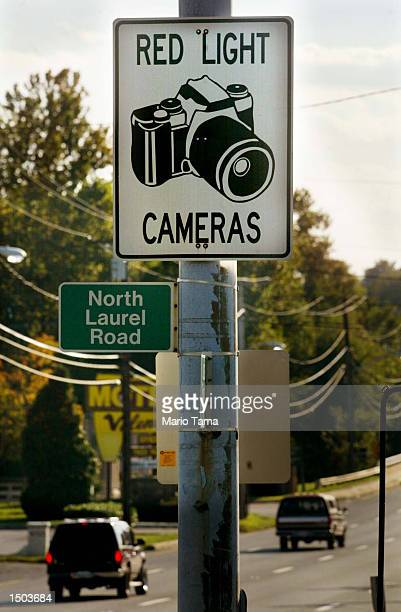 Cars drive past a red light camera sign on Route 1 October 18 2002 in Laurel Maryland Washingtonarea sniper investigators have been using red light...
