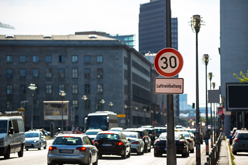 Cars drive past a sign of speed limit in Berlin, Leipziger Strasse (Germany) - gettyimageskorea