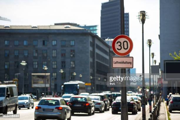 Cars drive past a sign of speed limit in Berlin, Leipziger Strasse (Germany)