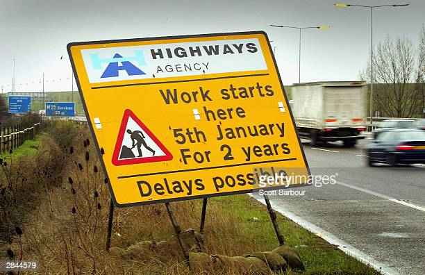 Cars drive past a sign on the M25 motorway informing them of road works due to the widening of the M25 on January 5 2004 in London The twoyear...