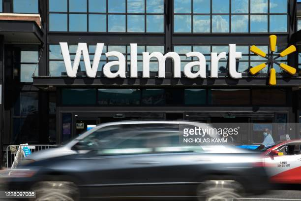 Cars drive past a Walmart store in Washington, DC, on August 18, 2020. - Walmart saw its profits jump in latest quarter as e-commerce sales surged...
