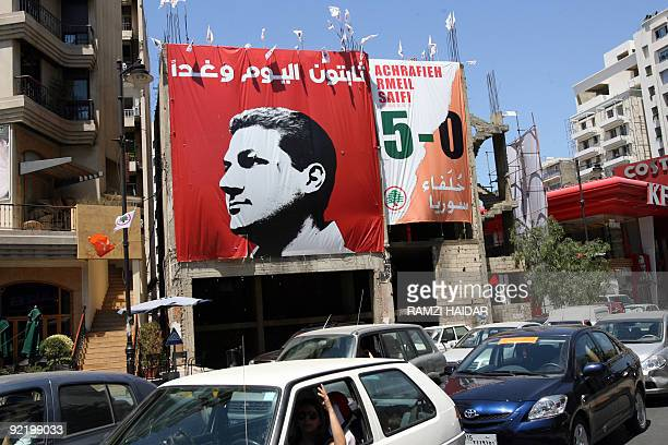 DAOU Cars drive past an electoral campaign billboard for Lebanese candidate Nadim Gemayel son of slain presidentelect Bashir Gemayel in Beirut's...