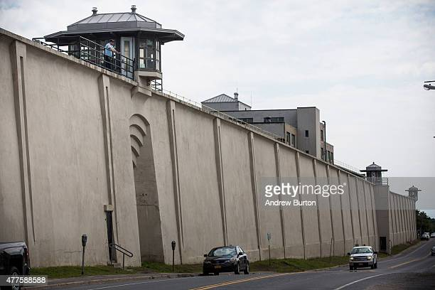 Cars drive past Clinton Correctional Facility on June 18, 2015 in Dannemora, New York. After conducting a manhunt across approximately 10,000 acres...