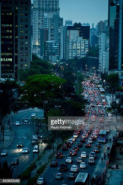 cars drive past Faria Lima's Avenue a main business avenue in Sao Paulo Brazil