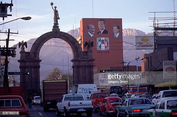 Cars drive past the Arco de la Independencia in Monterrey Mexico
