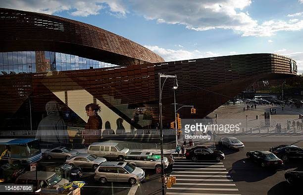 Cars drive past the Barclays Center in the Brooklyn borough of New York, U.S., on Sunday, Oct. 21, 2012. The Barclays Center, the 675,000-square-foot...