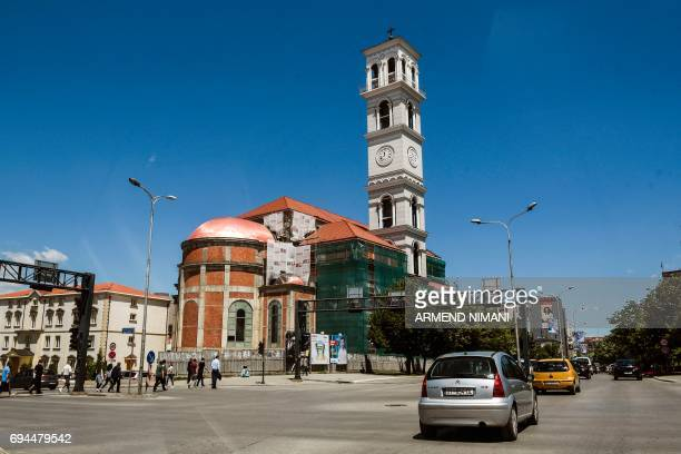 Cars drive past the Cathedral of Blessed Mother Teresa in Pristina on June 9 2017 Nine years after proclaiming independence fragile Kosovo votes on...