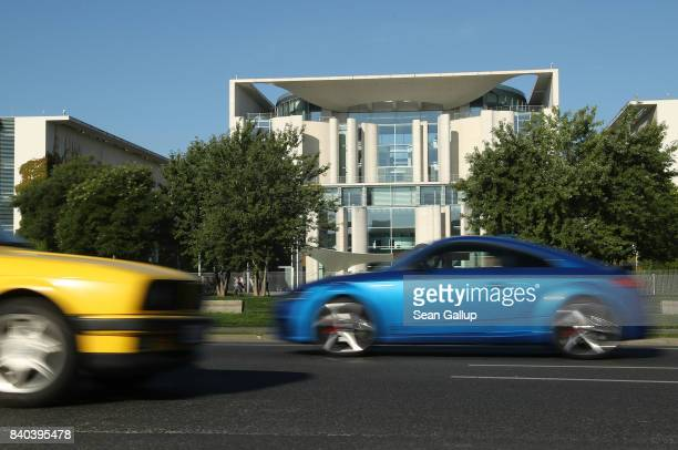 Cars drive past the Chancellery on August 29 2017 in Berlin Germany Germany faces federal elections on September 24 and political parties are...