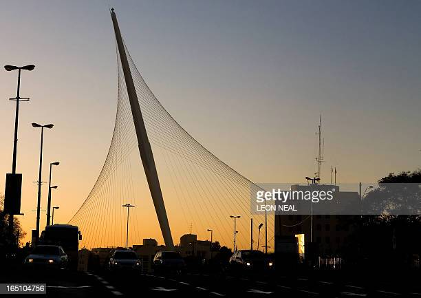 Cars drive past the Chords Bridge in central Jerusalem on January 27 2009 On completion of the Jerusalem Light Rail system the bridge will be used to...