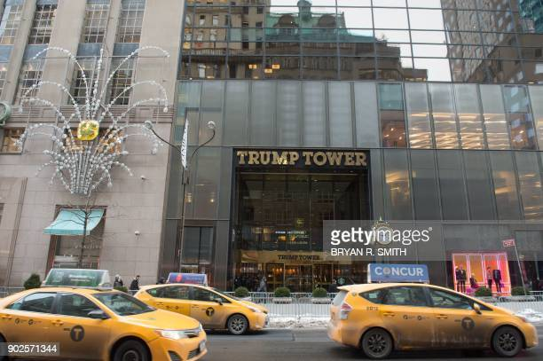 Cars drive past the front of Trump Tower on Fifth Avenue on January 8 2018 in New York A fire in the Trump Tower ventilation system in New York City...