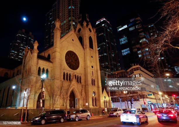 Cars drive past the Holy Name Cathedral in Chicago on December 19 2018 Almost 700 clergy in Illinois have been accused of child sexual assault a far...