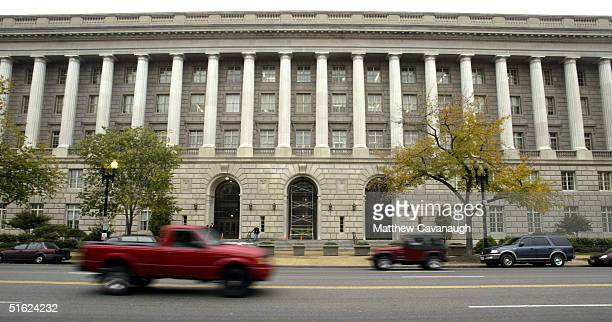 Cars drive past the Internal Revenue Service headquarters building October 29 2004 in Washington DC The IRS is investigating whether a speech by...