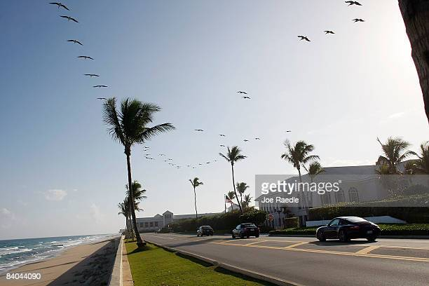 Cars drive past the Palm Beach Country Club where Bernard L Madoff is said to have recruited some of his investors to his fund December 15 2008 in...