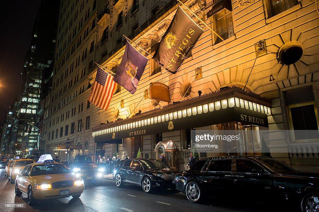 Cars Drive Past The St Regis Hotel A Starwood Hotels Resorts Worldwide Inc