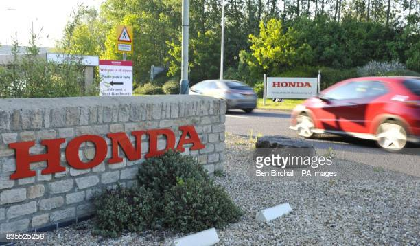 Cars drive through the main entrance to the Honda plant in Swindon Thousands of car workers will resume production today after a fourmonth layoff at...