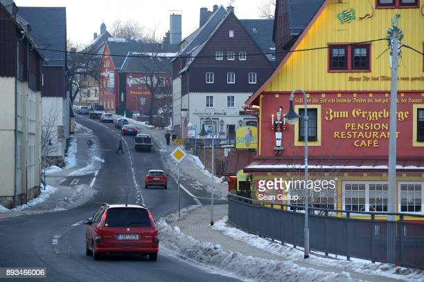 Cars drive through the town center on December 13 2017 in the former mining town of Altenberg Germany Altenberg will potentially experience a mining...
