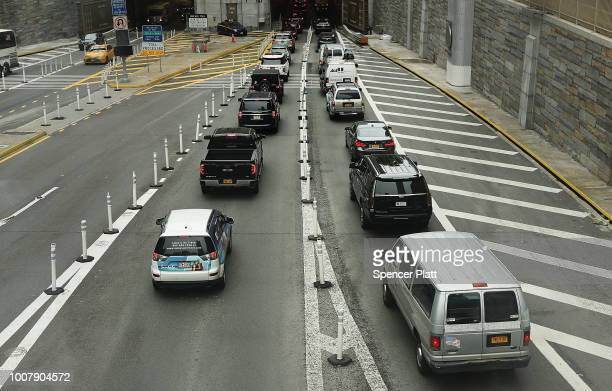 Cars drive towards the Lincoln Tunnel on July 30 2018 in New York City After a significant increase in local traffic and a spate of suicides by taxi...