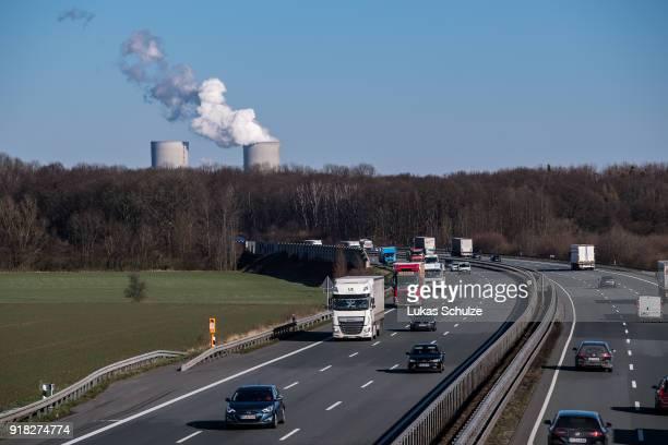Cars driving along the A2 highway pass near the RWE Kraftwerk Westfalen coalfired power plant on February 14 2018 near Hamm Germany The plant uses...